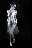 Silver Metal Clothing on a Body Painted Model Stock Photography