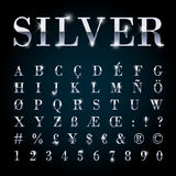 Silver metal font set letters, numbers, currency symbols. Silver metal font set with letters, numbers, currency sings and special alphabet symbols Royalty Free Stock Photos