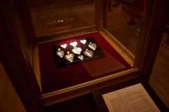 TRAKAI, LITHUANIA - JANUARY 02, 2013: Silver metal hearts in exhibition of Museum of Sacred Art. Silver metal hearts in exhibition of Museum of Sacred Art part stock photos