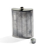 Silver metal hip flask for carrying whiskey Royalty Free Stock Images
