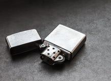 Silver metal lighter. Stock Photo
