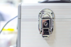 Silver metal lock. On a white suitcase Royalty Free Stock Photo