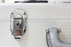 Silver metal lock. On a white suitcase Stock Photos