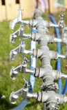 Silver metal outside water taps Royalty Free Stock Images