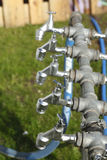 Silver metal outside water taps Royalty Free Stock Photo