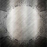Silver metal plate with classic ornament Stock Photo