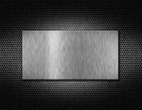 Silver metal plate on a grate Stock Image