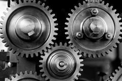 Silver Metal Round Gears Connected to Each Other Royalty Free Stock Image