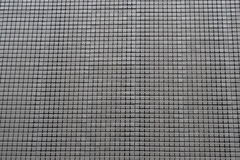 Silver metal squares grid pattern background Royalty Free Stock Images