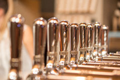 Silver metal taps at bar Royalty Free Stock Photography