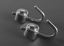 Silver metal towel hanger. On gray background Stock Photo