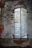 Silver Metal Window Shutters in Weathered Brick Wall royalty free stock images