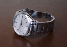 Silver Metal Wrist Watch on Tabletop Royalty Free Stock Photo
