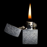 Silver metal zippo lighter isolated on black background Stock Photography