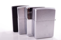 Silver metal zippo lighters on white Stock Photography