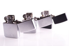 Silver metal zippo lighters on white Stock Image