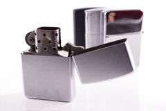 Silver metal zippo lighters on white Royalty Free Stock Photos