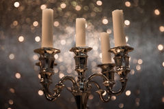 Silver metallic candelabra with candles Stock Photography
