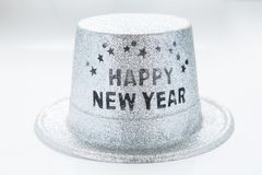 Silver metallic happy new year party hat isolated on white backg. Round royalty free stock images