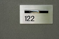 Silver metallic letterbox for home in grey wall Royalty Free Stock Images