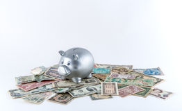 Silver Metallic Piggy Bank on Pile of Banknotes Royalty Free Stock Photo