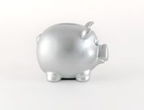 Silver Metallic Piggy Bank Side View. Silver metallic piggy bank, side view, on white background Stock Photography
