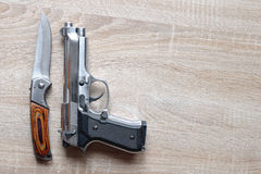 Silver metallic pistol with knife Royalty Free Stock Images