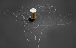 Silver metallic thread. On a black background Stock Photography