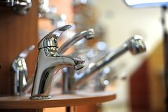 Silver metallic water tap Stock Photo