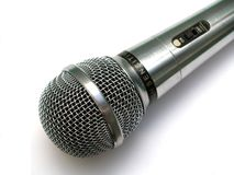 Silver Microphone. Silver vocla microphone with off/on swither on white background royalty free stock images