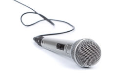 Silver microphone. On a white background stock photography