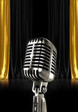 Silver microphone with black gold curtains Royalty Free Stock Photos