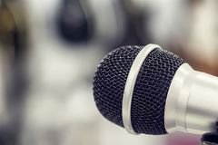 Silver microphone on blurred background. Voice, mic, entertainment, song sound royalty free stock images