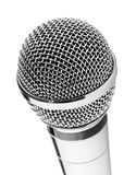 Silver microphone closeup. Silver microphone on white background royalty free stock photo