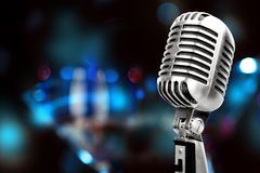 Silver microphone. Mic white old background instrument radio royalty free stock photos