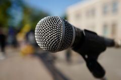 Silver Microphone. On open space stock image