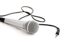 Silver microphone with  plug. Classic microphone with plug isolated on white Stock Image