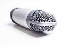 Silver microphone. Professional silver microphone on white background royalty free stock photo
