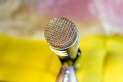 Silver microphone on rack closeup. Silver microphone on the rack closeup, colored background stock images
