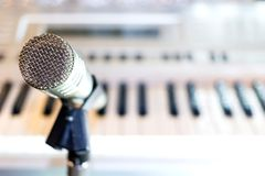 Silver microphone on rack closeup stock image