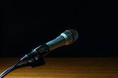 Silver microphone and stand. Black background royalty free stock photos