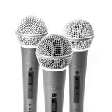 Silver microphone. Triple silver microphone isolated on white background royalty free stock photo