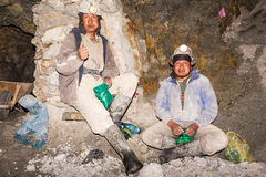 Silver Miners Relaxing in Potosi, Bolivia. POTOSI, BOLIVIA - JULY 19: Silver miners taking a break in the Cerro Rico mines in Potosi, Bolivia on July 19, 2014 Stock Image