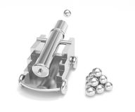 Silver miniature cannon firing cannonball. Isolated silver titanium mini cannon ball pyramid. Treasure hunting, trade war, economic competition, adult toy Stock Photos