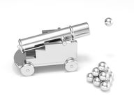 Silver miniature cannon firing cannonball. Isolated silver titanium mini cannon ball pyramid. Treasure hunting, trade war, economic competition, adult toy Stock Photo