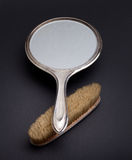 Silver mirror and comb Stock Photos