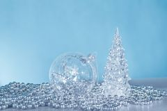 Silver monochrome Christmas ornaments on blue royalty free stock images