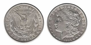 Silver Morgan dollar front and back side isolated on white stock photography