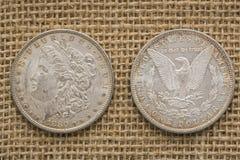 Silver Morgan US dollars 1880 burlap background Royalty Free Stock Image