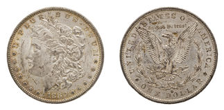 Silver Morgan US dollars 1880 isolated. The United States Morgan silver dollar coin is shown in obverse and reverse or front and back position and is tarnished royalty free stock photo